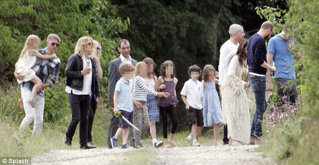 Farewell part: A group of the couple's friends and family, including Moss' ex Jefferson Hack (far left) gather in a field to watch the newlyweds take off