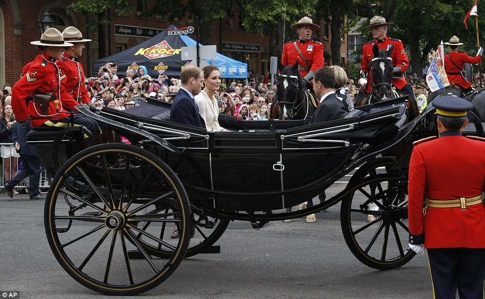 Mounted guard: The Duke and Duchess of Cambridge were driven through the streets in a horse-drawn landau with Prince Edward Island Premier Robert Ghiz and his wife Kate Ellis