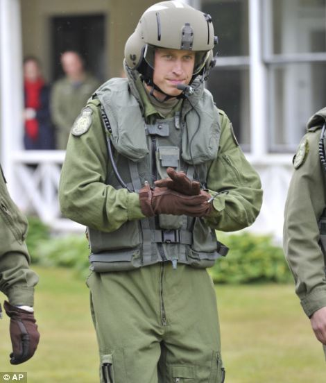 Geared for action: Prince William sets off toward the Sea King helicopter for the training exercise