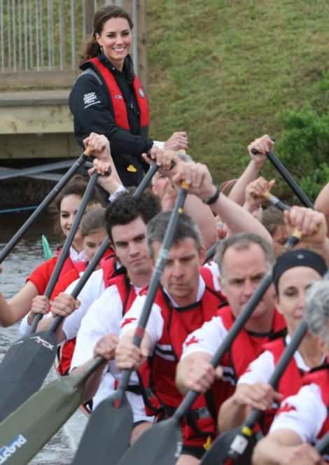 Kate and William 'steered' a team each in a dragon boat race on Dalvay Lake after he landed the helicopter on water