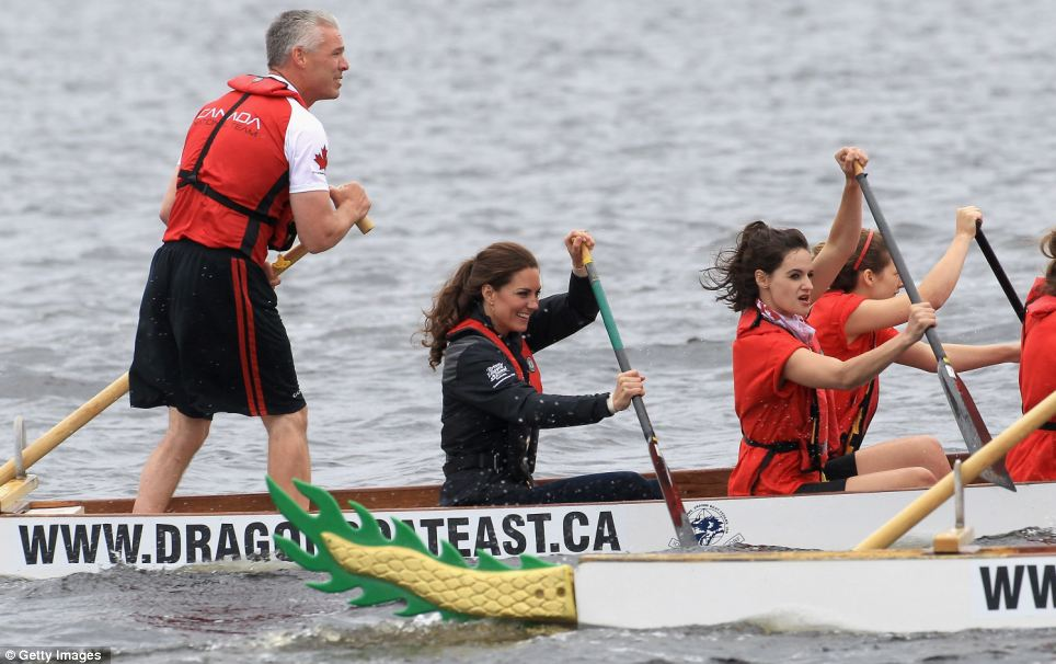 Competitive: Kate tries her best to catch up with William whose boat leads by several metres