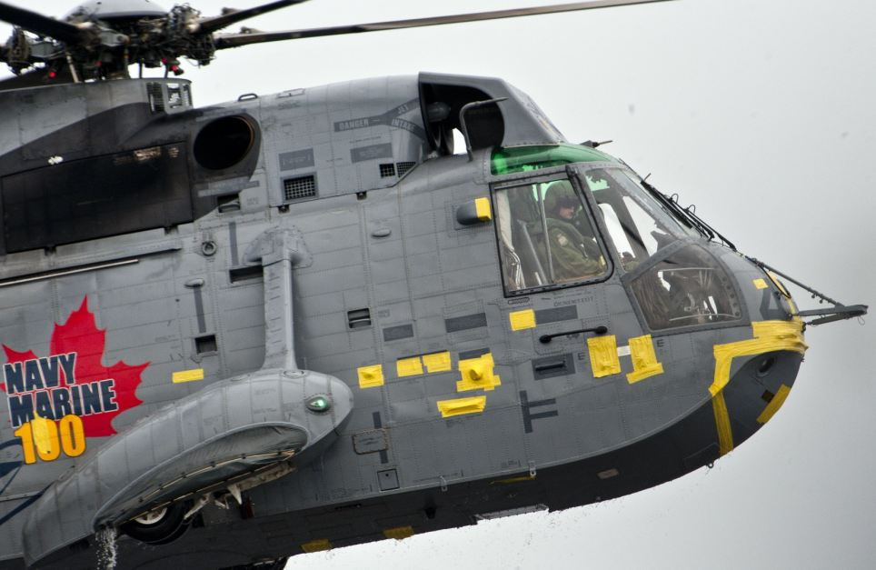 Prince William can be seen surveying the water below through the window of the Sea King as he takes off and lands several times