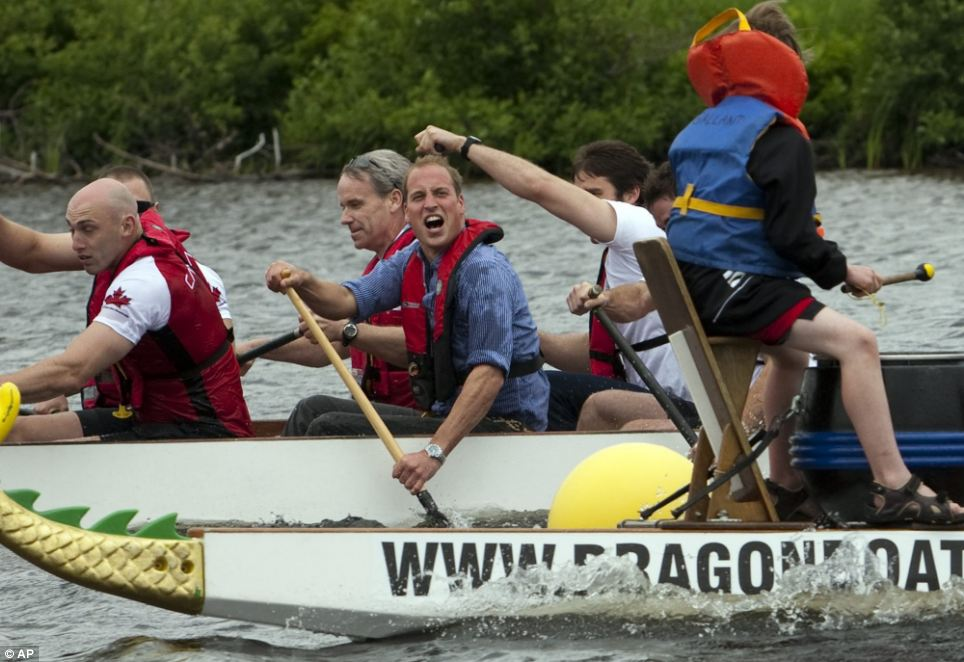 William got rather wet in the friendly dragon boat race but that did not stop his competitive spirit showing through, goading the opposition as he rows to victory