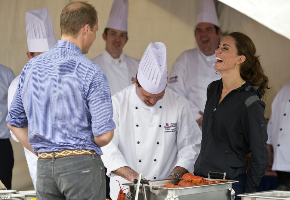 William, damp in patches from his rowing pursuits, makes Kate laugh heartily at something he said as a chef prepares a lobster for the couple