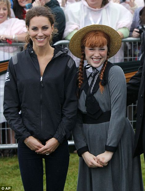 The Duchess of Cambridge poses with a girl dressed as the character Anne of Green Gables
