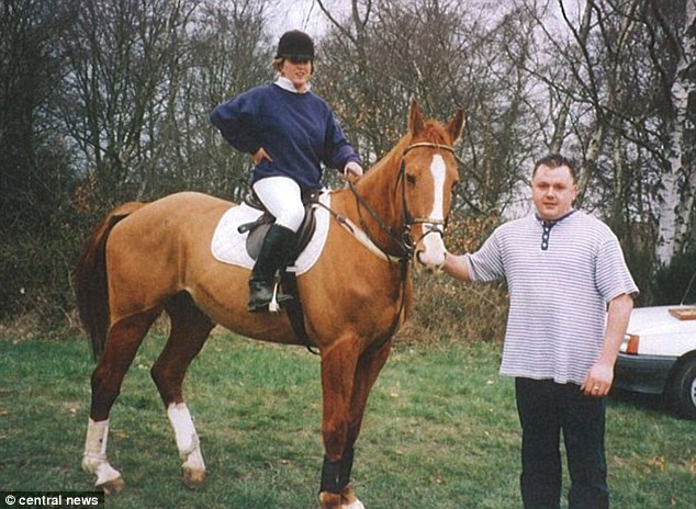 Abuse: Bellfield is seen here with his former girlfriend Johanna Collings at Yateley Heath - where Milly's body was found