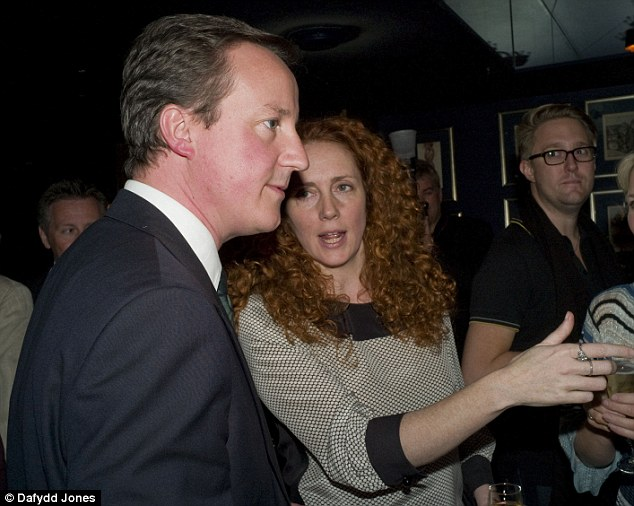 Close: Prime Minister David Cameron today condemned the hacking of Milly Dowler's phone by News of the World investigators while his friend Rebekah Brooks, right, was editor