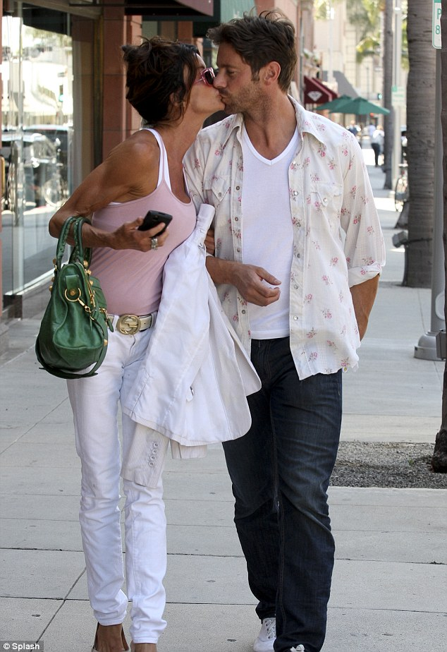 Puckering up: The couple were spotted getting intimate as they went for a stroll in Beverly Hills