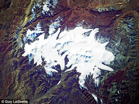 Snowy peaks, Northern Tibet taken by Guy Laliberte from space
