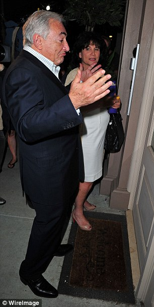 Locked out: Dominique Strauss-Kahn struggles to get into his apartment in Manhattan