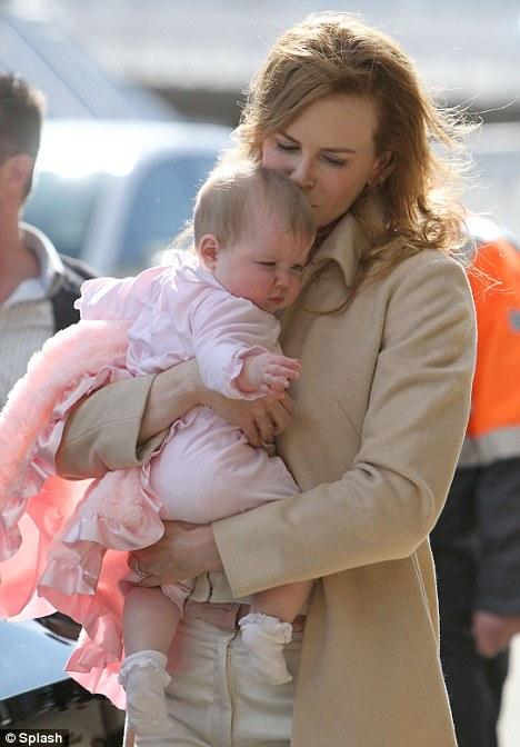 A mother's love: Kidman kissing baby Faith at Sydney airport ahead of the flight