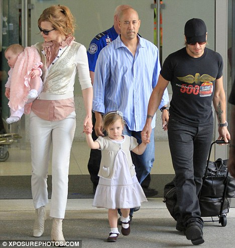 Close watch: Kidman keeps a close eye on Faith as the family walk through the airport