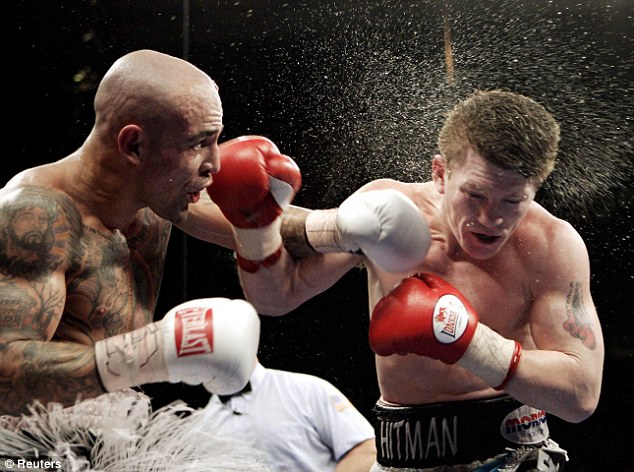 Tough test: Hatton steps up a weight and beats WBA welterweight world champion Luis Collazo in Boston in May 2006.