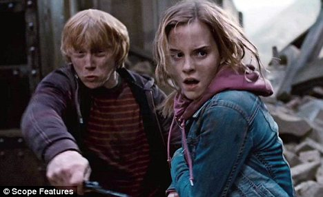 Awkward: Rupert Grint and Emma Watson said they worried about filming the kiss they shared in the last movie
