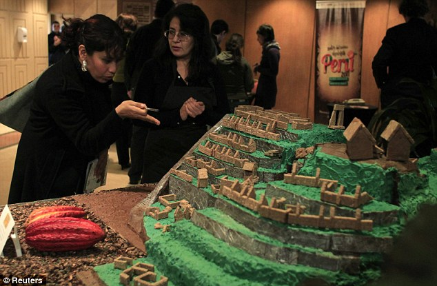 Sweet vision: Tourists look at a replica of  the Inca citadel Machu Picchu made of Peruvian cocoa during a chocolate convention in Lima