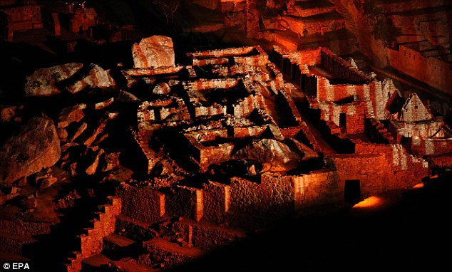 Red light city: The light show reveals  the Peruvian Inca citadel of Machu Picchu in Cusco
