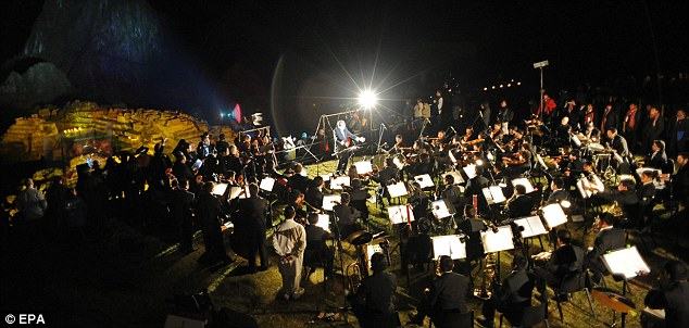 Musical high: The Symphonic Orchestra of Cusco performs at 2,350 metres during the night-time celebrations