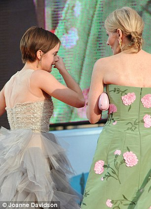 Tearful: Rowling tries to console Emma who was overcome with emotion at the premiere