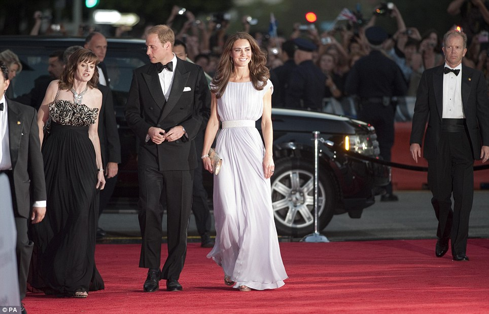 Hollywood royalty: Wearing a classic tuxedo, Prince William escorts Kate down the red carpet and into the Belasco Theatre in Los Angeles