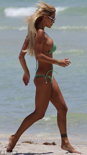 Sea run: Shauna shows off her striking figure to fill effect as she runs into the warm Miami ocean