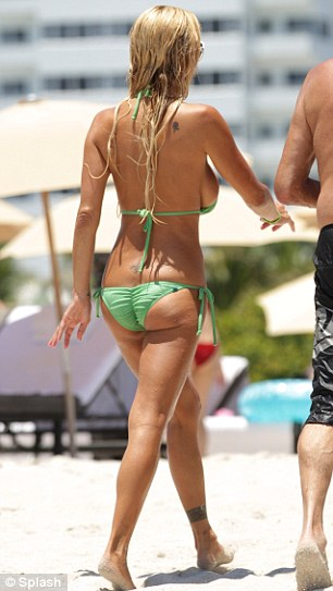 Sea run: Shauna shows off her striking figure to fill effect as she runs into the warm Miami ocean before leaving with wet long blonde hair