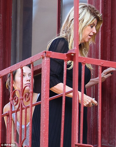 Unimpressed: Daughter Lillie Price doesn't seem to happy that mum is smoking