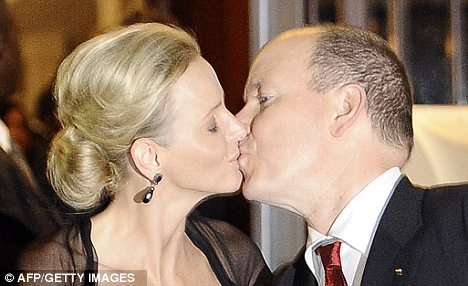 Awkward? Princess Charlene and Prince Albert II of Monaco put on a show by kissing each other during their honeymoon in South Africa