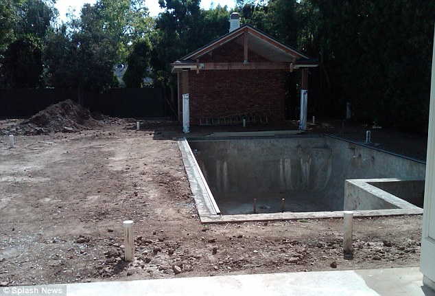 Needs work: It took several months to overhaul the property, seen here a view of the pool area while under construction