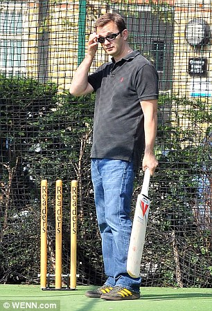 Andy Coulson in the cricket nets in a park in south London