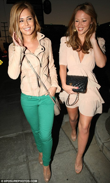 Firm friends: Cheryl and Kimberley heading out to dinner with Derek Hough on Friday night