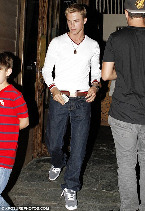 Unhappy: Derek Hough leaves Sushi Roku on Friday night after dinner with Cheryl
