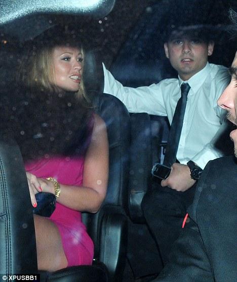 Colourful: Cole's Girls Aloud bandmate Kimberley Walsh appeared to be wearing a fuchsia mini dress