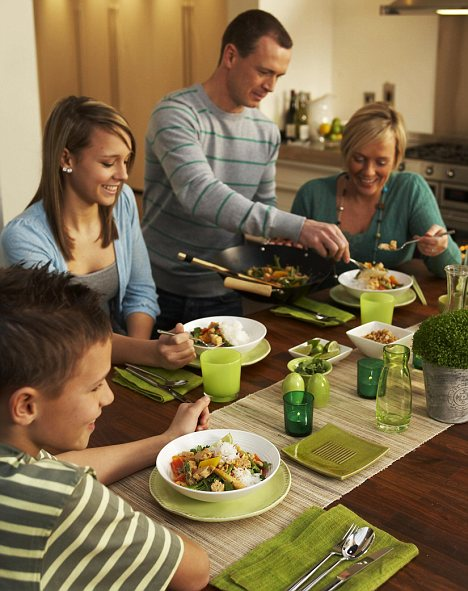 Happy families: Teenagers who eat with their parents are likely to be more connected, making conversations about bad diet and dangerous eating habits less awkward