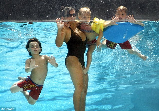 In good shape: Britney's mother Lynne Spears is looking in great shape as she played with her grandchildren in a hotel pool in Dallas