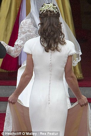 Pippa Middleton holding the train of her sister Catherine's wedding dress whilst heading into Westminster Abbey