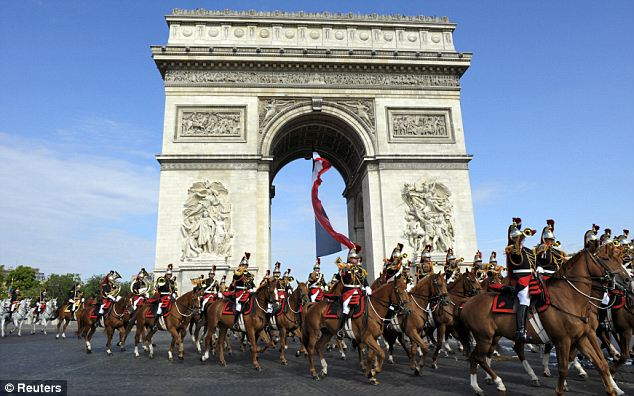 France's Republican Guard ride down the Champs-Elysees as part of the traditional parade