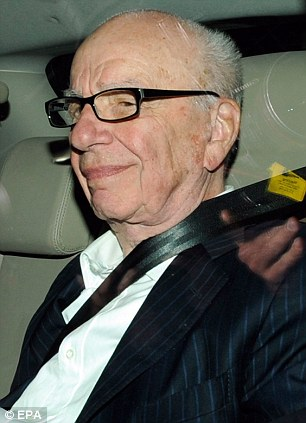 Probe: Rupert Murdoch, chairman of News Corp, is driven to his apartment in London. His company is facing calls for an investigation into claims it hacked into the phones of 9/11 victims