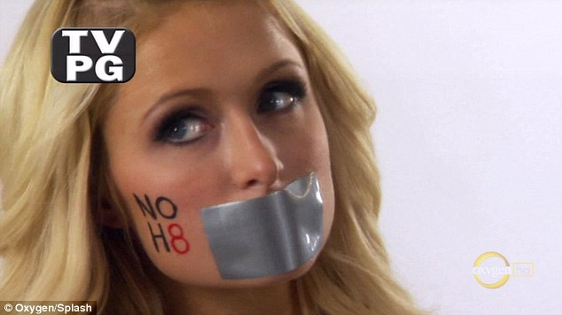 No hate: Paris Hilton poses with her mouth taped up and No H8 on her cheek to promote gay marriage in California
