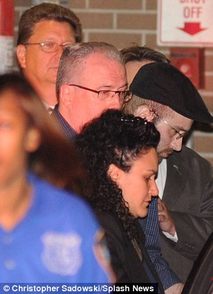 Walking: Levi Aron is moved by police from the 67th Police Precinct in Brooklyn on Wednesday
