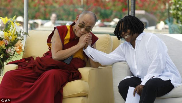 Gathering: The Dalai Lama holds Whoopi Goldberg's hand during the World Peace event on the West Lawn of the U.S. Capitol last Saturday