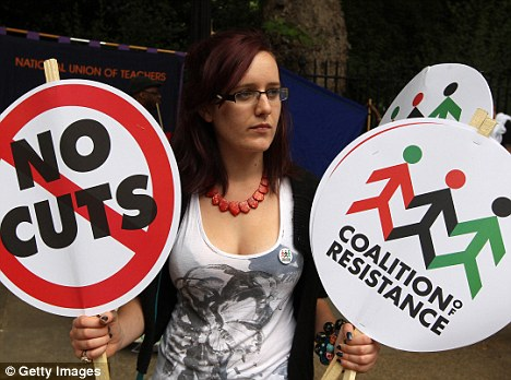 No cuts: A public sector worker prepares to take part in a march through central London, in Lincoln's Inn Fields, London, on June 30, 2011