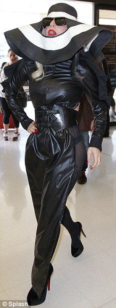 Run of the mill: Gaga leaves Sydney in a typical outfit