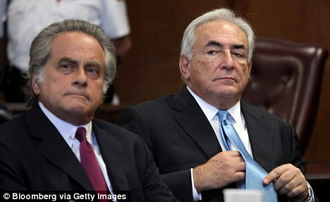 Out: Strauss-Kahn, seen here with his lawyer Benjamin Brafman at a court hearing earlier this month where he was released without bail after the credibility of the maid's claims was called into question