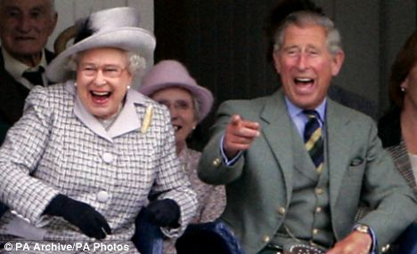 Laughter: The Queen and Prince of Wales enjoy the Braemar Highland Games