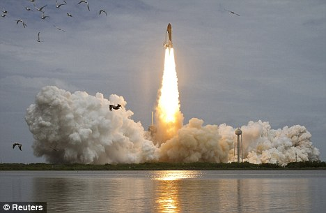 One last time: Space shuttle Atlantis lifts off from pad 39A at the Kennedy Space Center at Cape Canaveral, Florida, on July 8