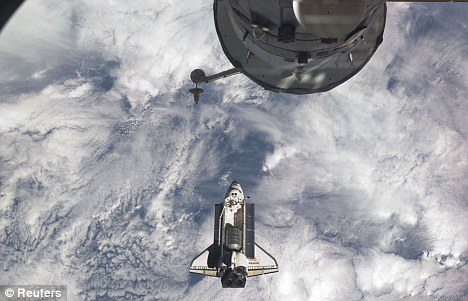Flying high: Atlantis soars above the earth before docking with the International Space Station on July 100