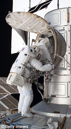 Spacemen: NASA astronaut Ronald Garan opens the Quest airlock on the International Space Station during a planned six-and-a-half-hour spacewalk