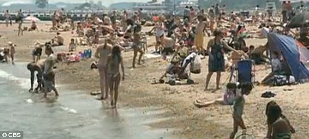 Staying close to the water: Families have been flocking to the beaches in a bid to keep cool