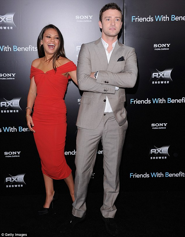 Red hot: Mila Kunis looked stunning in a figure-hugging dress as she attended the Friends With Benefits premiere in New York last night with co-star Justin Timberlake