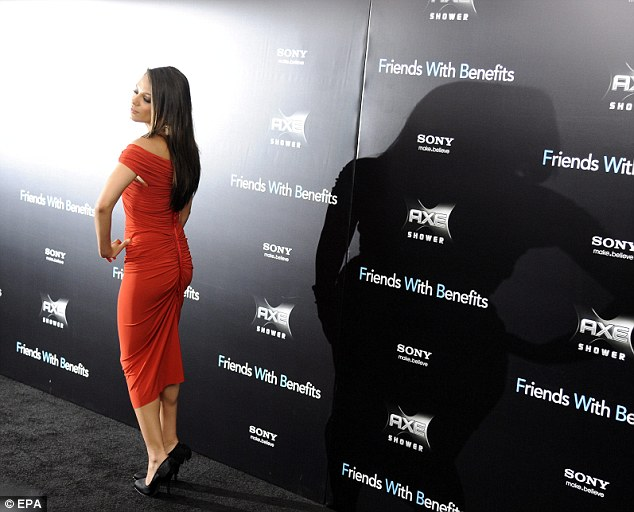 Hollywood glamour: Mila strikes a sexy pose as she has her photograph taken outside the Ziegfeld Theatre